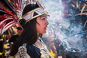05 OCTOBER 2013 - PHOENIX, ARIZONA: A woman in a stylized in an Aztec costume carries incense during a march for immigration reform in Phoenix. More than 1,000 people marched through downtown Phoenix Saturday to demonstrate for the DREAM Act and immigration reform. It was a part of the National Day of Dignity and Respect organized by the Action Network.   PHOTO BY JACK KURTZ