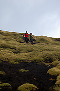 Hikers descending Valle del Bove, on the Southern slopes of Mount Etna, The highest and most active volcano in Europe, Nicolosi, Sicily, Italy July 2006