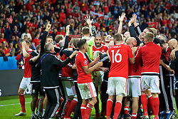 LILLE, FRANCE - Friday, July 1, 2016: Wales players and staff celebrate the 3-1 victory against Belgium after the UEFA Euro 2016 Championship Quarter-Final match at the Stade Pierre Mauroy. (Pic by Paul Greenwood/Propaganda)