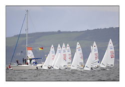 470 Class European Championships Largs - Day 2.Wet and Windy Racing in grey conditions on the Clyde...Women, Start, Fleet, Committee Vessel..