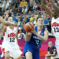 11 August 2012: France Marion Laborde drives past Sylvia Fowles during 86-50 Team USA victory over Team France, during the Women's Gold Medal Game, at the North Greenwich Arena, in London, Great Britain.