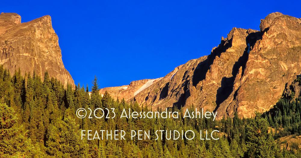 Rocky Mountain National Park's Hallet Peak in golden sunrise light. From original film image.