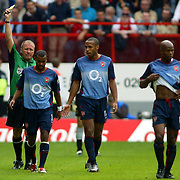 Arsenal's Ashley Cole (l)  picks up a yellow card as team mate Thierry Henry berates him