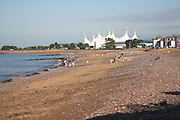 Beach with view towards the Butlins Holiday camp, Minehead, Somerset, England