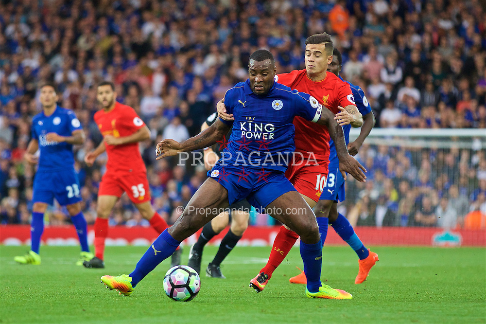 LIVERPOOL, ENGLAND - Saturday, September 10, 2016: Liverpool's Philippe Coutinho Correia in action against Leicester City's captain Wes Morgan during the FA Premier League match at Anfield. (Pic by David Rawcliffe/Propaganda)