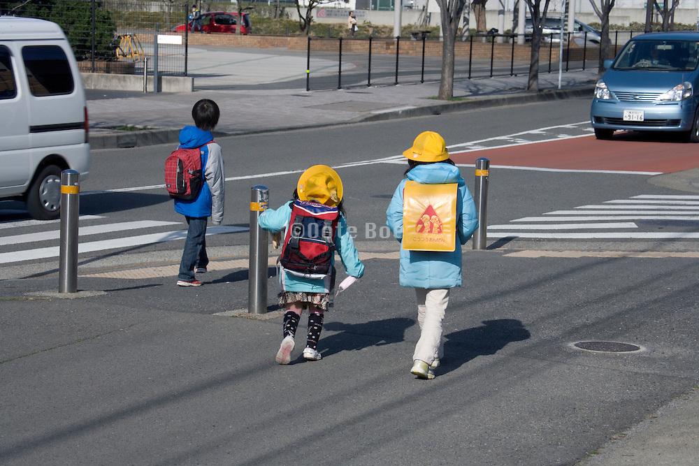 Japanese elementary schoolchildren walking to school