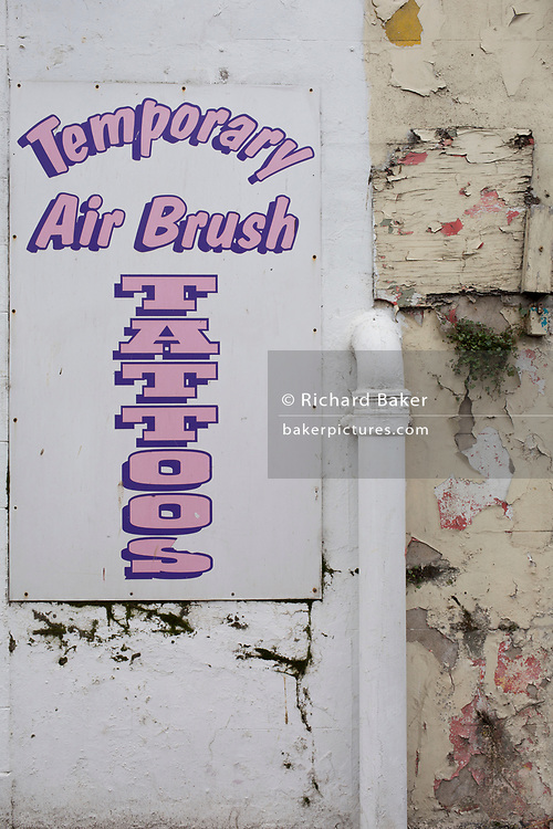 Detail of a sign outside a seaside trinket shop selling temporary tattoos, on 14th July 2017, at Scarborough, North Yorkshire, England.