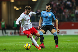 November 10, 2017 - Warsaw, Poland - Grzegorz Krychowiak (POL), Maximiliano Gomez (URU) in action during the international friendly match between Poland and Uruguay at National Stadium on November 10, 2017 in Warsaw, Poland. (Credit Image: © Foto Olimpik/NurPhoto via ZUMA Press)