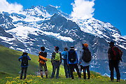 Japanese tourists viewing the Jungfrau mountain peak in the Swiss Alps in Bernese Oberland, Switzerland