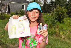 Great Cranberry Island Ultra 50K road race: young race volunteer with Gu packets