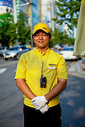 """Portrait of a young man working as a car adviser for a big shopping mall called """"E-Mart"""" in the city of Daegu, South Korea."""