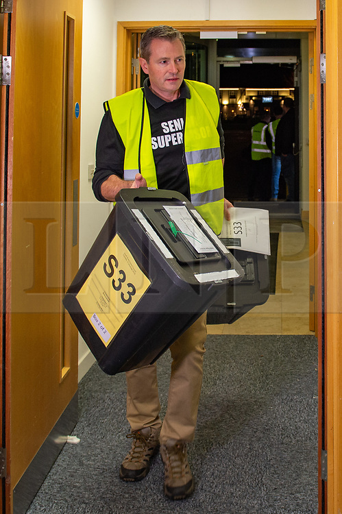 © Licensed to London News Pictures. 12/12/2019. Denham, UK. The first ballot boxes arrive at the offices of the South Bucks District Council for the Beaconsfield constituency vote count for the 2019 General election. Photo credit: Peter Manning/LNP
