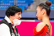 Oiva Chisaki talks with her coach at the Rhythmic Gymnastics World Cup in Pesaro.