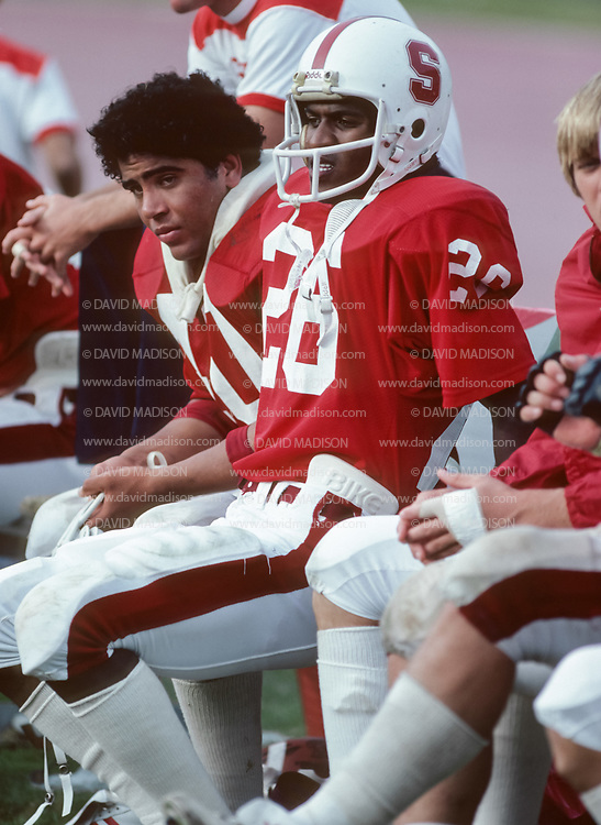 COLLEGE FOOTBALL:  Mike Tolliver, #26, Greg Hooper #40, John Elway (partially visible at right), Stanford Stadium, October 1981.  Photograph by David Madison | www.davidmadison.com.