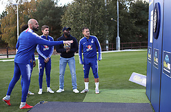 Chelsea's goalkeeper Willy Caballero (left), Jorginho (second left), Eden Hazard (right) and Willian (hidden) take part in various challenges set by William Hill at Chelsea Cobham Training complex.