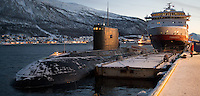 Indian Navy Diesel-Electric Submarine INS Sindhurakshak Docked Next to the Hurtigruten M/S Finnmarken in Tromsø Norway. The 16 year old submarine was built in Russia, and was returning from a 2 year upgrade in Russia. Composite of 3 images taken with a Nikon 1 V2 camera and 18.5 mm f/1.8 lens (ISO 800, 18.5 mm, f/1.8, 1/30 sec) combined using AutoPano Giga Pro.