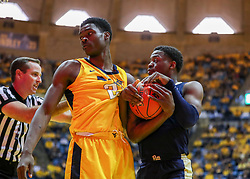 Dec 8, 2018; Morgantown, WV, USA; West Virginia Mountaineers forward Wesley Harris (21) and Pittsburgh Panthers guard Xavier Johnson (1) fight for a loose ball during the first half at WVU Coliseum. Mandatory Credit: Ben Queen-USA TODAY Sports