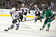 DALLAS, TX - SEPTEMBER 26:  Nathan MacKinnon #29 of the Colorado Avalanche controls the puck against the Dallas Stars in an NHL preseason game on September 26, 2013 at the American Airlines Center in Dallas, Texas.  (Photo by Cooper Neill/Getty Images) *** Local Caption *** Nathan MacKinnon