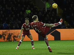 Bristol City's Aden Flint tries an acrobatic effort