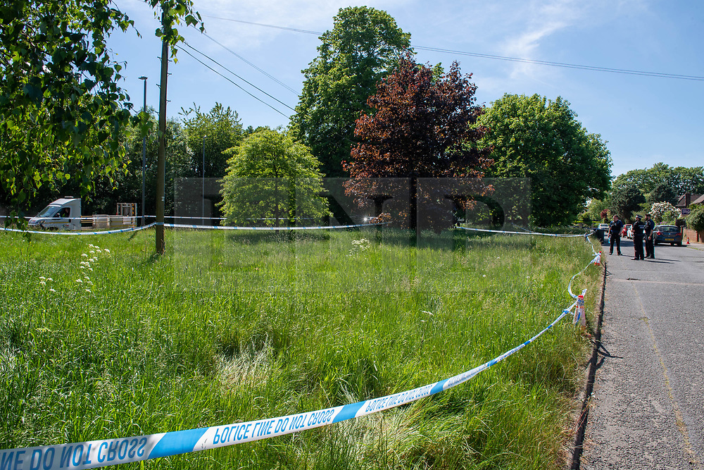 © Licensed to London News Pictures. 21/05/2020. Beaconsfield, UK. Police tape marks a cordon around a large grassed area parallel to North Drive and the A40 in Beaconsfield. Thames Valley Police were called to North Drive, Beaconsfield at around 00:01 BST on Thursday 21/05/2020 to a report of a stabbing. A man in his forties had sustained injuries consistent with stab wounds and was taken to hospital. Photo credit: Peter Manning/LNP