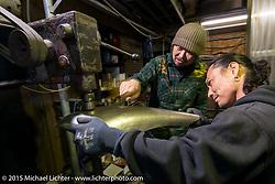 Custom Works Zon partners Yuichi Yoshizawa (L) and  Yoshikazu Ueda shaping sheet metal in their shop in Shiga Prefecture, Japan. December 8, 2015.  Photography ©2015 Michael Lichter.