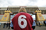a West Ham fan wearing the famous Bobby Moore no 6 shirt outside Boleyen Ground before k/o. The Emirates FA cup, 6th round replay match, West Ham Utd v Manchester Utd at the Boleyn Ground, Upton Park  in London on Wednesday 13th April 2016.<br /> pic by John Patrick Fletcher, Andrew Orchard sports photography.