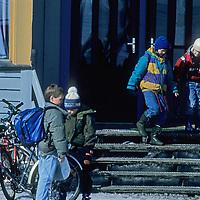 SPITSBERGEN, Norway, Longyearbyen children leave school for home.