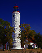"""""""Imperial Tower"""" style Point Clark Lighthouse built of limestone blocks in 1859, shore of Lake Huron, Bruce County, Ontario, Canada."""