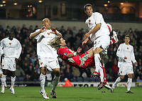 Photo: Paul Thomas.<br /> Blackburn Rovers v Basle. UEFA Cup. 02/11/2006.<br /> <br /> Blackburn's Robbie Savage (Red) has his over head shot at goal blocked by Basel defender's Reto Zanni (R) and Daniel Majstorovic (L).