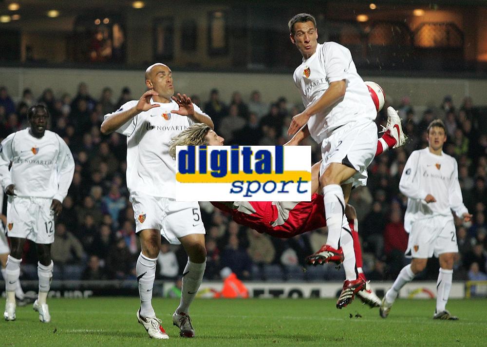 Photo: Paul Thomas.<br /> Blackburn Rovers v Basle. UEFA Cup. 02/11/2006.<br /> <br /> Blackburn's Robbie Savage (Red) has his over head shot at goal blocked by Basel defender's Reto Zanni (R) and Daniel Majstorovic (L).