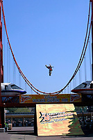 """Jul 01, 2003; Anaheim, California, USA; Moto X star athlete MIKE METZGER executing a tremendous stunt with a full sized motobike over the Park's replica of the Golden Gate Bride for the opening of Disney's California Adventure """"X Games Experience"""".  Disney park has built two X-Arena's specifically for this 41 day event highlighting extreme sports for the launch of the 2003 ESPN X Games.<br />Mandatory Credit: Photo by Shelly Castellano/Icon SMI<br />(©) Copyright 2003 by Shelly Castellano"""