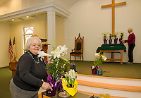 """Jane Rollins and Sandra Stafford of the """"flower committee"""" decorates Gilford Community Church with Lilies, Tulips and Hyacynths for the Easter Sunday services.  (Karen Bobotas/for the Laconia Daily Sun)"""