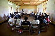 Intrahealth staff John Mobti teaches a group of SLPA peer counselors.