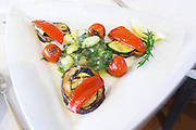Fresh salad with grilled vegetables in local style, bell pepper, aubergine zucchini tomatoes and herbs from the luxury Excelsior Hotel and Spa restaurant terrace Dubrovnik, old city. Dalmatian Coast, Croatia, Europe.