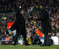 Photo: Chris Ratcliffe.<br /> Barcelona v Chelsea. UEFA Champions League. 07/03/2006.<br /> Jose Mourinho gives Frank Rijkaard the arm