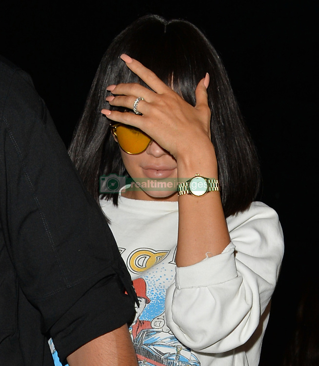 EXCLUSIVE Kylie Jenner and boyfriend Travis Scott visit Ours Restaurant in Kensington for a romantic meal together. Kylie was wearing a ring on her engagement finger. However their mood soon turned for the worse when Kylie discovered model Ella Ross was also inside the venue with friends. Ella had a fling recently with Scott Disick, ex husband of Kylie's sister Kourtney Kardashian. Upon hearing the news, Kylie and Travis left in a hurry, staying inside for barely more than 30 minutes and covered their faces as they walked to a waiting car.<br /> <br /> 8 July 2017.<br /> <br /> Please byline: WE GOT BLOCKED/Vantagenews.com