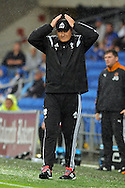 Cardiff City manager Russell Slade salutes the fans by doing the ayatollah. Skybet football league championship match, Cardiff city v Wolverhampton Wanderers at the Cardiff city stadium in Cardiff, South Wales on Saturday 22nd August 2015.<br /> pic by Carl Robertson, Andrew Orchard sports photography.