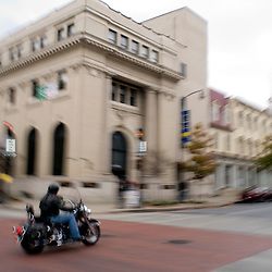 Frederick, Maryland - A motorcylcist cruises up N. Market Street at the corner of Patrick in downtown Frederick..Photo by Susana Raab