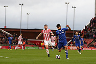 Diego Costa of Chelsea breaks away from Phil Bardsley of Stoke city . Premier league match, Stoke City v Chelsea at the Bet365 Stadium in Stoke on Trent, Staffs on Saturday 18th March 2017.<br /> pic by Andrew Orchard, Andrew Orchard sports photography.