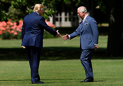 The Prince of Wales (right) meets US President Donald Trump as he arrives in Marine One at Buckingham Palace, in London on day one of his three day state visit to the UK.