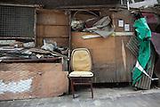 An empty chair in a Beijing hutong.