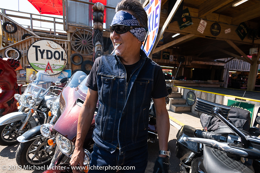 Ken's Factory's Ken Nagai of Nagoya Japan and friends at the the Iron Horse Saloon during the Sturgis Black Hills Motorcycle Rally. Sturgis, SD, USA. Tuesday, August 6, 2019. Photography ©2019 Michael Lichter.