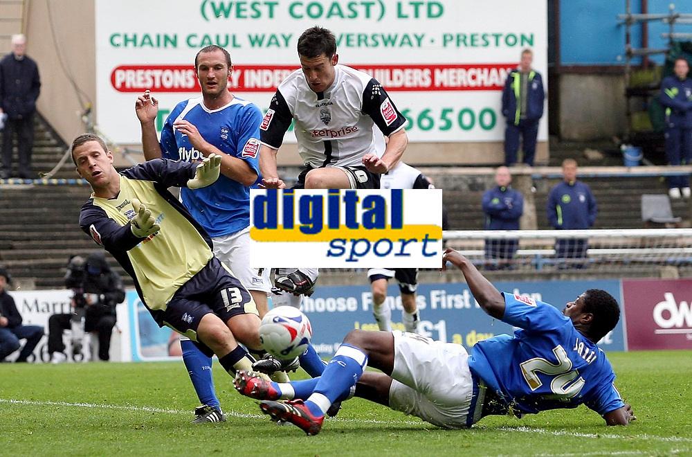 Photo: Paul Thomas.<br /> Preston North End v Birmingham City. Coca Cola Championship. 06/05/2007.<br /> <br /> David Nugent (White) of Preston tries to get through Radhi Jaidi (R) an keeper Colin Doyle (L) to score, but has no luck.