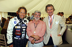 "Left to right, The EARL OF MARCH, GEORGE LUCAS and ARNAUD BAMBERGER at the Goodwood Festival of Speed on 9th July 2006.  Cartier sponsored the ""Style Et Luxe' for vintage cars on the final day of this annual event at Goodwood House, West Sussex and hosted a lunch.<br />