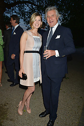 ROSAMUND PIKE and ARNAUD BAMBERGER at a dinner hosted by Cartier in celebration of The Chelsea Flower Show held at The Hurlingham Club, London on 19th May 2014.