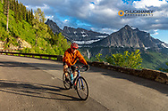 Road bicycling on Going to the Sun Road befor auto traffic is allowed in Glacier National Park, Montana, USA MR