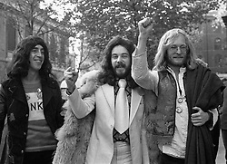 """File photo dated 03/11/1971 of the three Oz magazine editors (left to right) Richard Neville, Felix Dennis and James Anderson in London where they went to the Appeal Court to challenge their Old Bailey conviction on obscenity charges. The Victoria and Albert Museum (V&A) has acquired """"one of the most important records of 20th Century counter-cultural revolution"""" - the archive relating to the magazine Oz."""