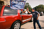 "26 SEPTEMBER 2020 - DES MOINES, IOWA: GARY LEFFLER, an organizer of the motorcade supporting the reelection of Donald J. Trump, ""high fives"" people in the motorcade as it passes the Iowa State Capitol. More than 1,500 people in 500 vehicles participated in motorcade through Des Moines Saturday. They started in the suburbs south of downtown, drove through downtown, and ended at the State Capitol.       PHOTO BY JACK KURTZ"
