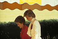 First Lady Nancy Reagan and Princess Diana of Wales walk to a drug treatment center in November 1985..Photograph by Dennis Brack bb24
