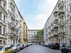 Typical street view of traditional apartment buildings and cobbled streets in Kreuzberg Berlin Germany